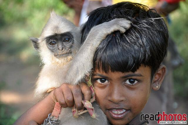 Gypsy little girl with her pet, Sri Lanka