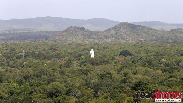 Buddha statue Sigiriya temple, mountain top view, Sri Lanka