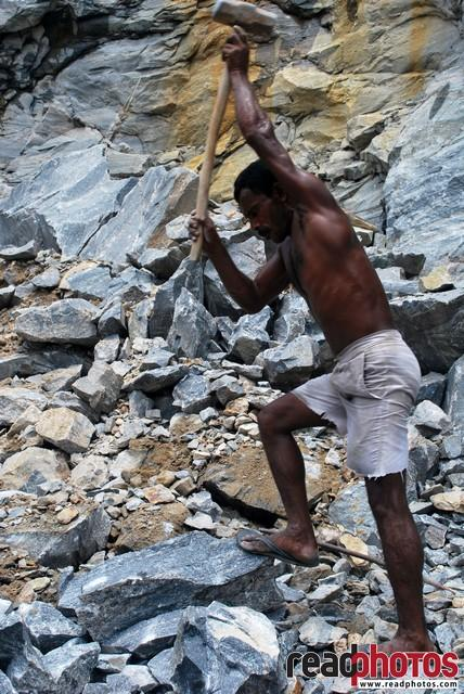 A man work in a Quarry, Sri Lanka - Read Photos